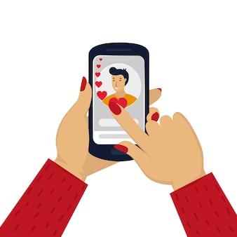 Mão de mulher segurando um telefone com um retrato de homem site de namoro ou namoro online