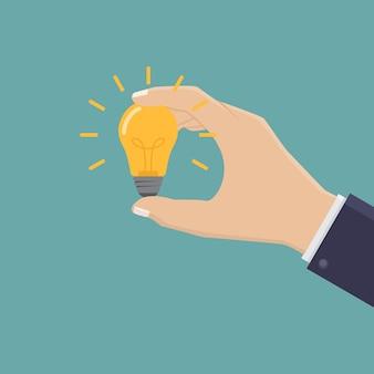 Mão de negócios criativos segurando ilustração de design de lâmpada