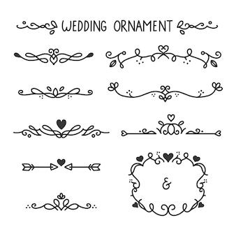 Mão de ornamentos de casamento desenhada