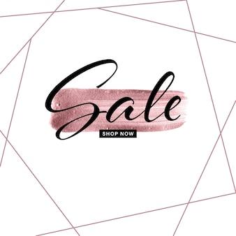 Mão de traçado de pincel rosa ouro desenhado com texto de venda