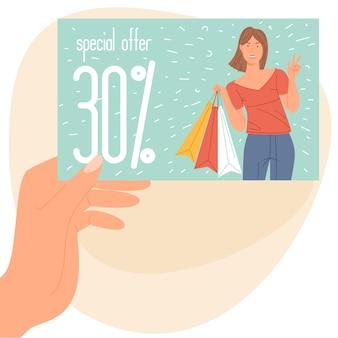 Mão de uma mulher segurando um cartão de compras de desconto de cliente do clube de fidelidade