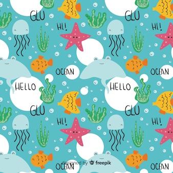 Mão desenhada animais marinhos e padrão de palavras