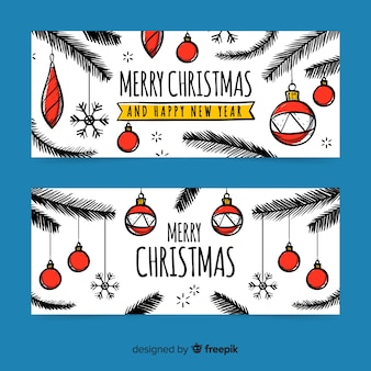Mão desenhada banners de natal com bolas de natal