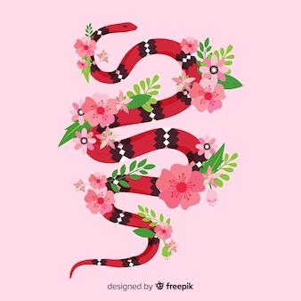 Mão desenhada cobra coral com fundo de flores