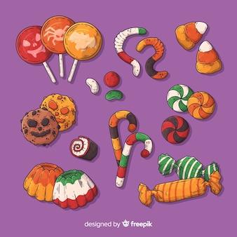 Mão desenhada coleção de doces de halloween no fundo roxo