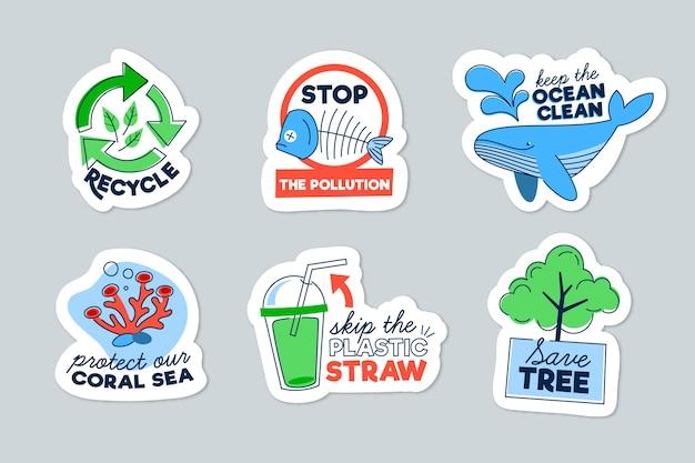 Mão desenhada conceito de emblemas de ecologia