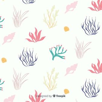 Mão desenhada coral com fundo de animais do mar