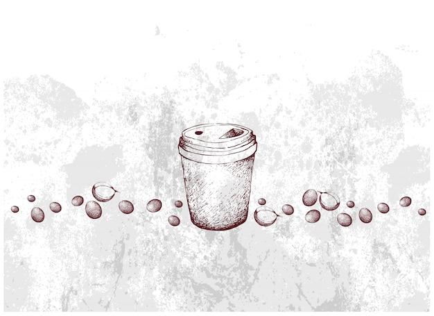 Mão desenhada de xícara de café descartável com feijão torrado