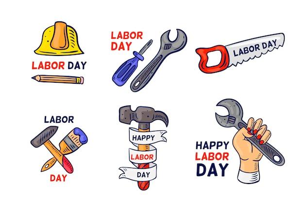 Mão desenhada design emblemas do dia do trabalho