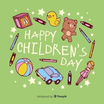 Mão desenhada dia das crianças brinquedos fundo