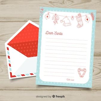 Mão desenhada envelope de natal e carta conceito