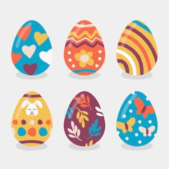 Mão desenhada feliz dia de páscoa conjunto de ovos coloridos