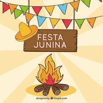 Mão desenhada festa junina fundo com fogueira