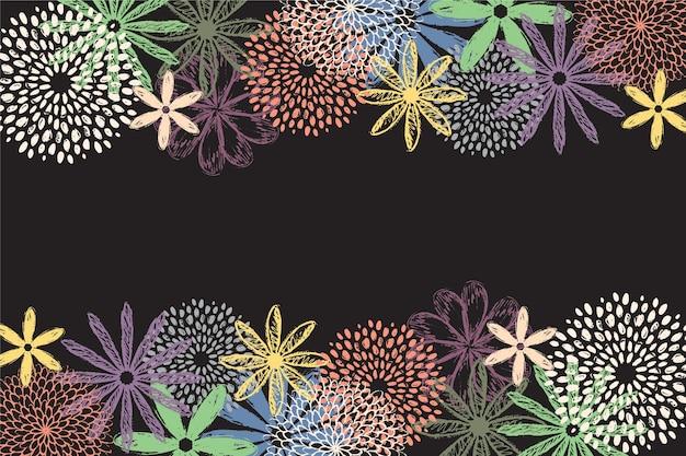Mão desenhada flores coloridas em fundo de quadro-negro