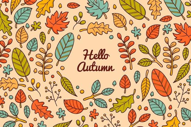 Mão desenhada fundo outono com folhas