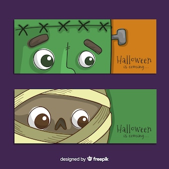 Mão desenhada halloween banners close-up monstro enfrenta