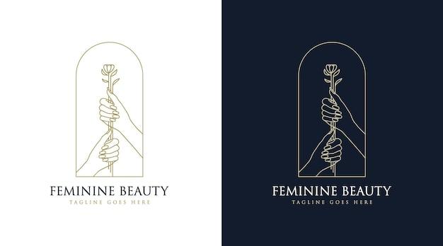 Mão desenhada logotipo boho de beleza feminina com mão de mulher unhas flor e folha para marca de salão e spa