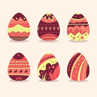 Mão desenhada ovos pintados de vermelhos e amarelos