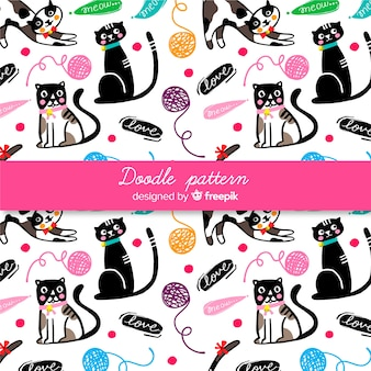Mão desenhada palavras e gatos padrão