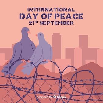 Mão desenhada pombas de dia internacional da paz