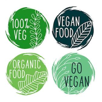 Mão desenhada símbolos e rótulos de comida vegetariana orgânica