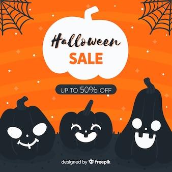 Mão desenhada venda de halloween com abóboras smiley