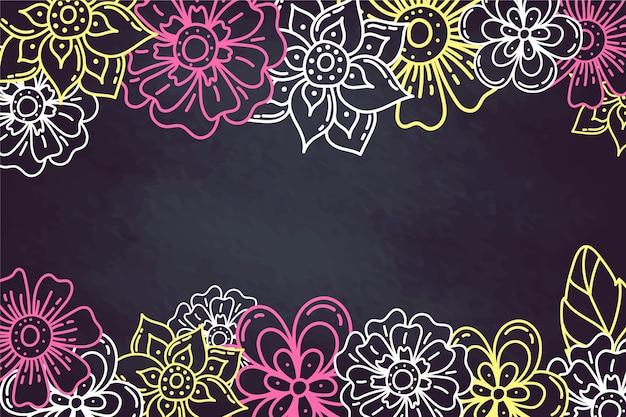 Mão desenhadas flores sobre fundo de quadro de giz