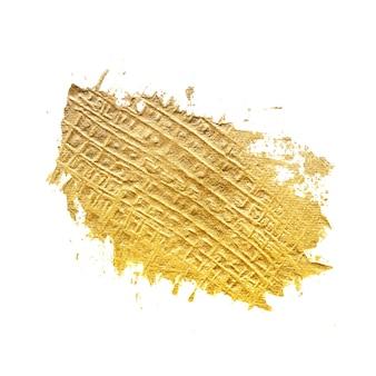 Mão desenhando tinta dourada com pincelada