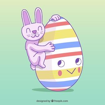 Mão do coelho desenhada feliz com ovo de páscoa