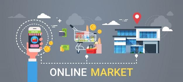 Mão em linha da bandeira da web do mercado que guarda o conceito esperto da entrega das compras na mercearia e do alimento dos produtos do telefone esperto