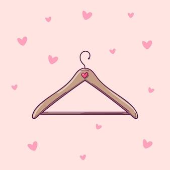Mão-extraídas cabide de roupas de vetor isolado em um fundo rosa com corações.