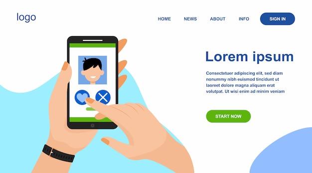 Mão feminina segurando telefone com aplicativo de encontro