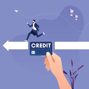 Mão grande com cartão de crédito, ajudando o empresário a alcançar o objetivo - conceito de apoio financeiro.