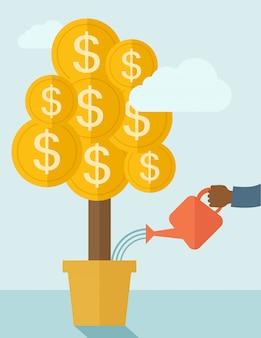 Mão humana a regar a árvore do dinheiro.