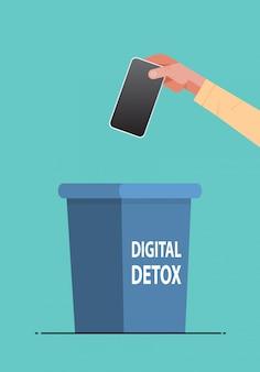 Mão humana jogando fora o smartphone no resto de desintoxicação digital de urna do conceito de dispositivos