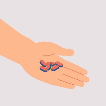 Mão humana mantém a pilha de pílulas e comprimidos isolados