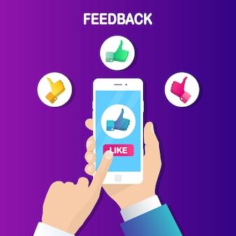Mão humana segura o telefone móvel com os polegares para cima o sinal. curtidas nas redes sociais, feedback do cliente, excelente avaliação, voto