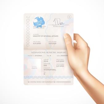 Mão humana segurando maquete de passaporte biométrico internacional com assinatura de titulares e datas de validade e nome da autoridade que emite o passaporte realista