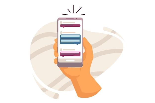Mão humana segurando smartphone com ilustração de mensagem de texto online