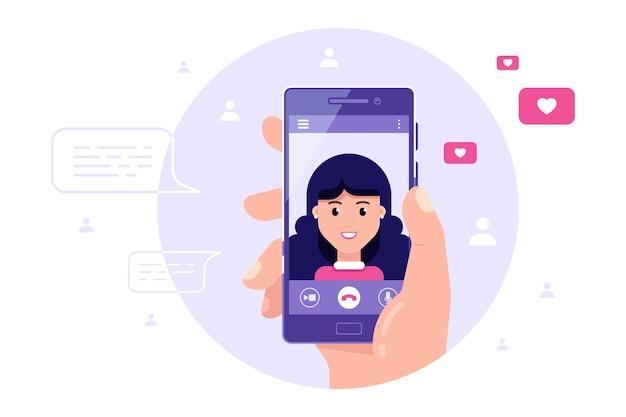 Mão humana segurando smartphone com personagem feminina na tela. videochamada, vídeo chat online