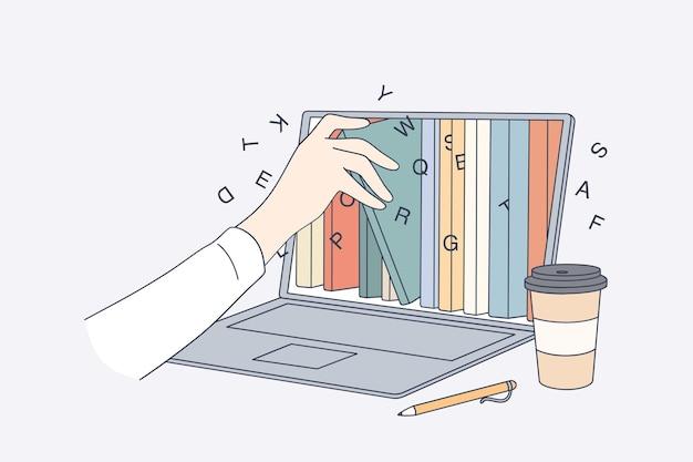 Mão humana tirando e-book da tela do laptop