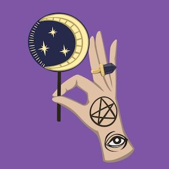 Mão mágica ritual de halloween com doces da lua.