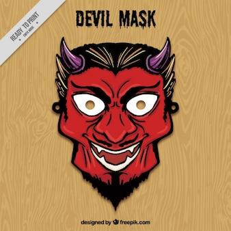 Mão máscara do diabo desenhada