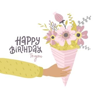 Mão masculina segurando buquê de flores, cartão de feliz aniversário com letras