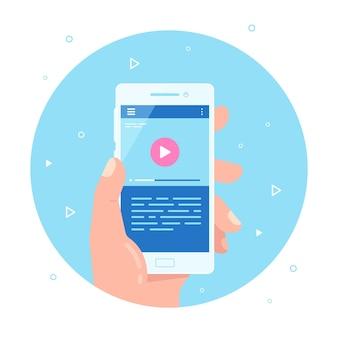 Mão masculina segurando o telefone móvel com o player de vídeo na tela. aplicativo de vídeo móvel. streaming de vídeo no telefone.