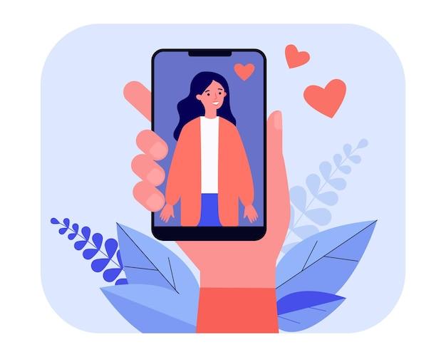 Mão masculina segurando smartphone com foto de mulher. amor, coração, ilustração vetorial plana de telefone