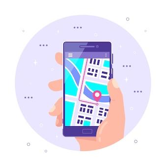 Mão masculina segurando smartphone com mapa e ponteiro gps em sua tela. mapas offline e posicionamento gps, conceito de navegação móvel