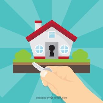 Mão plana segurando o fundo da chave da casa