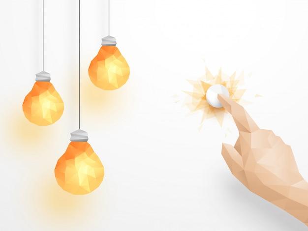 Mão pressionando o interruptor de luz acendendo lâmpadas incandescentes