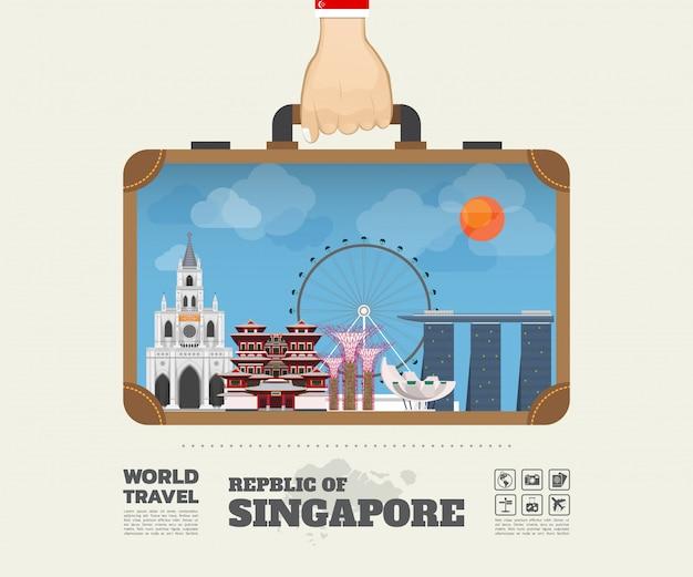 Mão que carrega o saco global de infographic do curso e da viagem do marco de singapore.